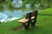 foto of nea  - chair nea lake garden without people sitting there