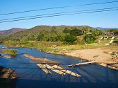 Bamboo Rafts In Pai River Viewed From Memorial Bridge In Pai, Mae Hong Son, Thailand