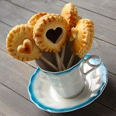foto of shortbread  - Homemade shortbread cookies pops with chocolate in cup - JPG
