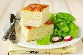Squares Of Zucchini And Rice Bake With Green Salad And Radishes