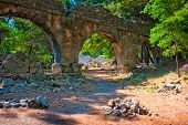 stock photo of aqueduct  - Aqueduct ruins in the ancient city of Phaselis - JPG