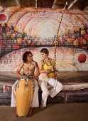 Capoeira Couple Playing Music