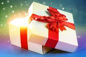 Gift box with bright light on it on bright background