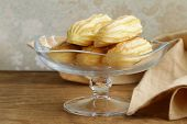 stock photo of eclairs  - choux pastry eclairs on glass stand base - JPG