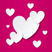 Paper hearts Valentines day card on pink.