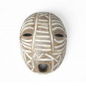 A tribal mask from Africa isolated on white