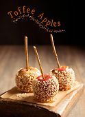 Candy apples covered in chopped nuts for bonfire night