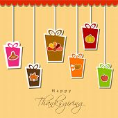 Happy Thanksgiving Day celebration concept with hanging colorful gift boxes on vintage background.