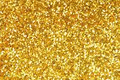 stock photo of twinkle  - close up of the golden sparkle glittering background - JPG