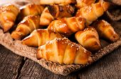 stock photo of continental food  - Selective focus on the front small croissant - JPG