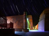 Ancient town of Itchan Kala at night with star trails. The city of Khiva, Uzbekistan