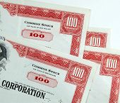 picture of nyse  - red common stock certificates of an american corporation - JPG