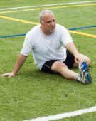 foto of stretching exercises  - overweight middle age senior man stretching his muscles fitness healthy lifestyle image - JPG