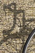 Bike Shadow Brick Wall