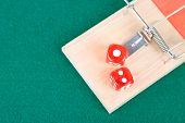 Mousetrap with dices on green background