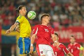 VIENNA,  AUSTRIA - JUNE  7 Sebastian Proedl (#15 Austria) and Zlatan Ibrahimovic (#10 Sweden) fight