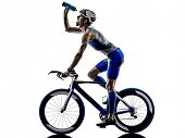 man triathlon iron man athlete bikers cyclists bicycling biking drinking in silhouettes on white bac