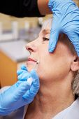 Woman Having Botox Treatment At Beauty Clinic