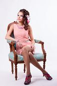 Brunette In A Pink Dress Sitting On A Chair In Baroque Style