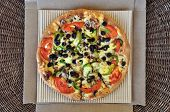 picture of takeaway  - Vegetarian pizza with tomato olives pepper mushrooms and onions packaged in cardboard box - JPG