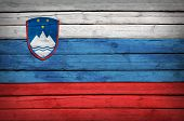 Slovenian flag painted on wooden boards