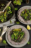 stock photo of cuttlefish  - Cuttlefish ink spaghetti with broccoli - JPG