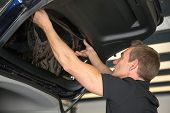 picture of car-window  - Car wrapping specialist attaching tinting foil to car window
