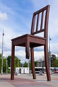 stock photo of landmines  - Geneva broken chair in front of the united nation building  - JPG