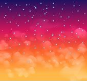 A magical Nigh sky with stars and delicate clouds. Idea for Christmas background and festive posters.