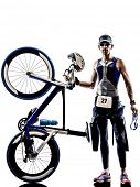 image of triathlon  - man triathlon iron man athlete standing with all his equipment in silhouettes on white background - JPG