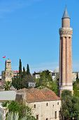 ANTALYA, TURKEY - MARCH 26, 2014: Yivli minaret mosque and clock tower in Antalya. Built in XIV cent