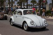 JACKSONVILLE BEACH, FL - APRIL 27, 2014: A classic Volkswagen Beetle at the 68th annual Opening of t