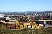 Containers And Warehousing Against Suburban Skyline