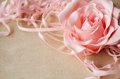 Beige Linen With Pink Rose And Ribbons As Vintage Background