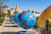 JERUSALEM, ISRAEL - AUGUST 21, 2013: 18 big globes exposed in Old City of Jerusalem as part of Cool