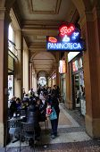 BOLOGNA, ITALY - APRIL 19, 2014: People enjoy coffee at an outdoor cafe in Bologna, Italy, on Saturday, April 19, 2014.