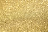 stock photo of gold glitter  - Gold Glitter Sparkles Background Texture with Selective Focus - JPG