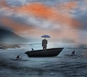Composite image of businessman holding umbrella in a sailboat being circled by sharks