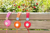 Three Varicolored Headphones Of Different Colors