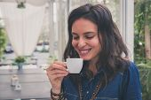 Pretty Girl Drinking A Cup Of Coffee