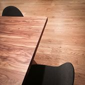 Wooden Table And Black Chairs