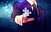 Piece Of Puzzle With Businessman