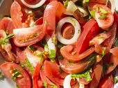 Salad From Tomatoes With Onions And Greens