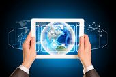 Man hands using tablet pc. Image of Earth on screen