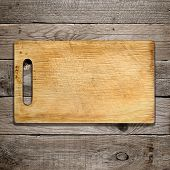 Old Chopping Board On Wooden Background
