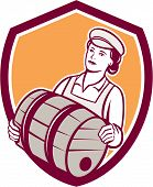 stock photo of keg  - Illustration of a female bartender worker carrying keg set inside shield crest on isolated background done in retro style - JPG