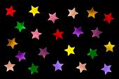 Collection of multicolored stars isolated on black background
