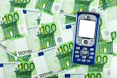 Mobile phone on money background, business concept