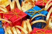 Multicolored gifts and ribbon, abstract holiday background