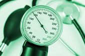 Scale of pressure and stethoscope - abstract medical background